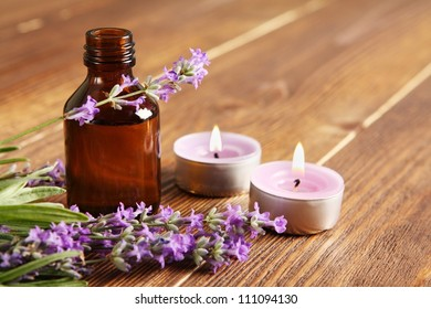essential oil on a wooden background