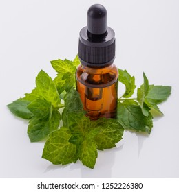 essential oil of peppermint on a white background