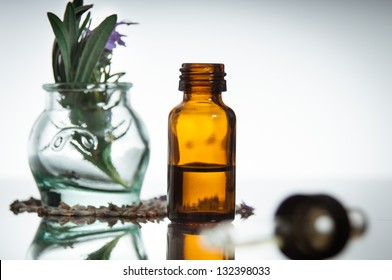 essential oil with rosemary and lavender flowers