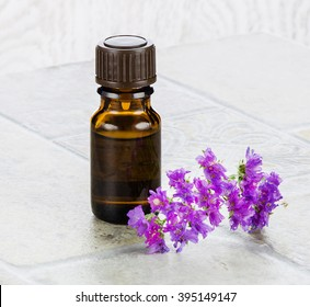 Essential oil and violet flower. Provence style