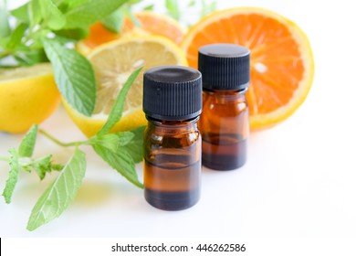 essential oils with citrus fruits and mint