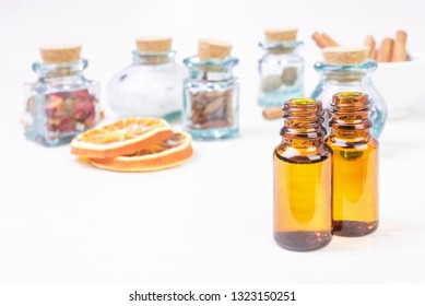 Essential oils in glass bottles on wooden background