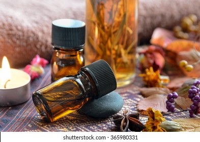 essential oils with herbs and candle