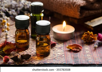 essential oils with herbs in candle light