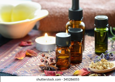 essential oils with herbs and herbal drink in white background