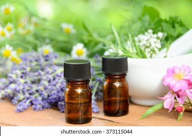 essential oils with herbs and mortar