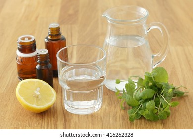 Essential oils with lemon, mint and water