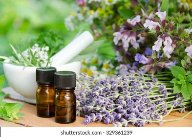essential oils and a mortar with herbs