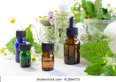 essential oils with natural cosmetics and herbs