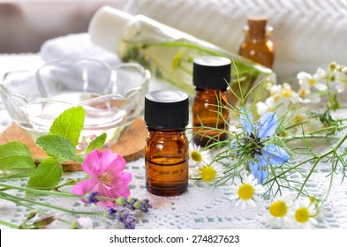 essential oils and natural cosmetics with rose flowers for aromatherapy treatment