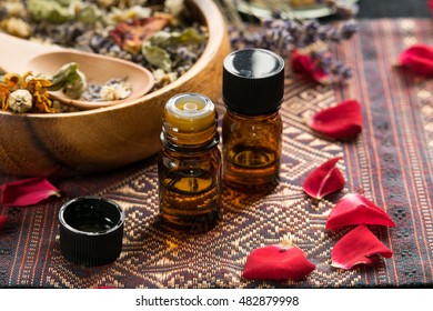 essential oils with rose and dried herbs