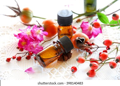 essential oils with rose hips and flowers