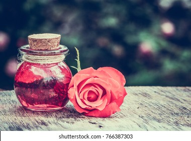 Essential rose oil in a glass bottle. Love elixir. Love potion.
