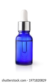 Essential serum oil in blue bottle with silver cap and white dropper  isolate on white background. Clipping path.