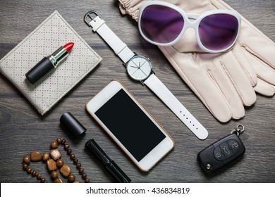 Essentials fashion objects on wooden table
