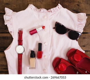 Essentials fashion woman objects on wooden background - Shutterstock ID 269667053