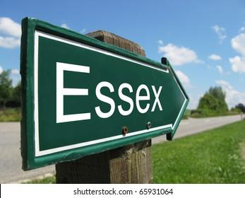 ESSEX arrow signpost along a rural road