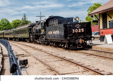 ESSEX, CT, USA - MAY 24, 2015: Connecticut Valley Railroad Steam Train Locomotive in train station.