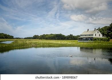 Essex Salt Marsh - an original farm house adds to the beauty of the salt marsh in Essex, Massachusetts