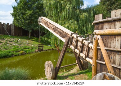 Essex, UK - 31 August, 2018: Ducking stool, torture tool in the Norman village reconstruction, educational centre for kids with historical activities and every day medieval life experience