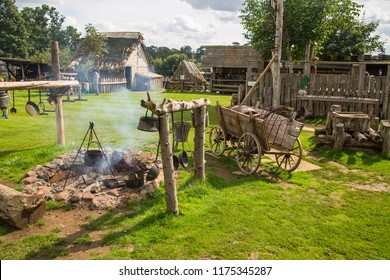 Essex, UK - 31 August, 2018: Main square with collective collective cooking fire in the Norman village. Educational centre for kids with historical activities and every day medieval life experience