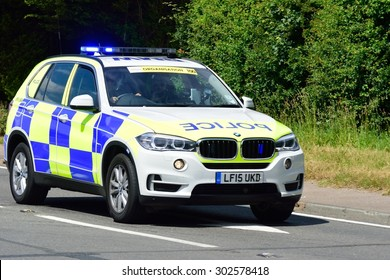 ESSEX  UK 7 JUNE  2015: Police Escort BMW