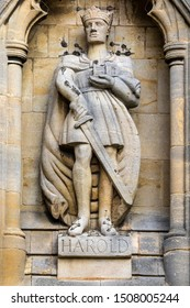 Essex, UK - August 27th 2019: Sculpture of Harold Godwinson, also known as King Harold, on the exterior of Waltham Abbey church in Essex, UK. King Harold died at the Battle of Hastings in 1066.