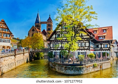 ESSLINGEN, GERMANY - APRIL 17, 2018: The photo shows the old quarter of Esslingen with the old building Alte Zimmerei surrounded by the Neckar river in the foreground