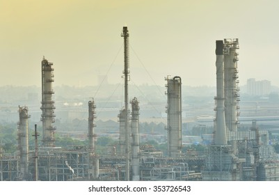 Esso Oil refinery- December 14,2015 , Petrochemical industrial with city background at sunset in Si Racha District, Chon Buri , Thailand