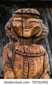 ESSO VILLAGE, KAMCHATKA PENINSULA, RUSSIA - SEP 18, 2013: Traditional wood carving - wooden sculpture of young woman Even - indigenous inhabitant of Kamchatka Peninsula. Bystrinsky Ethnographic Museum