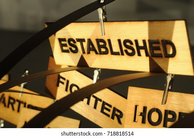 ESTABLISHED on a wooden sign, photograph Aspirations word