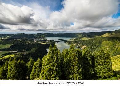 Establishing shot of the Lagoa das Sete Cidades lake taken from Vista do Rei in the island of Sao Miguel, The Azores, Portugal.