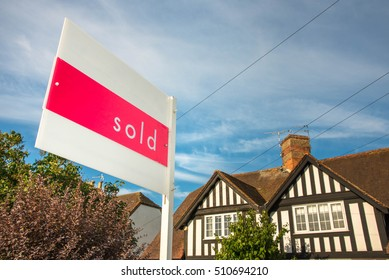 Estate agency sold sign for a traditional English property. UK real estate market is a prosper business, a huge bubble that could pop in any moment.