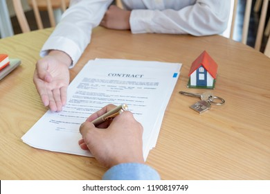 estate agent with customer after contract signature of buying house