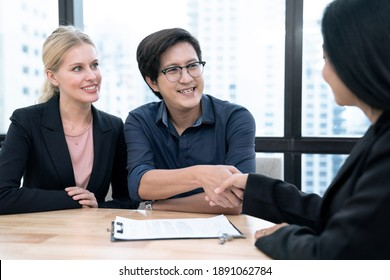 Estate agent shaking hands with customer after contract signature, Successful lawyer giving consultation to family couple about buying house.