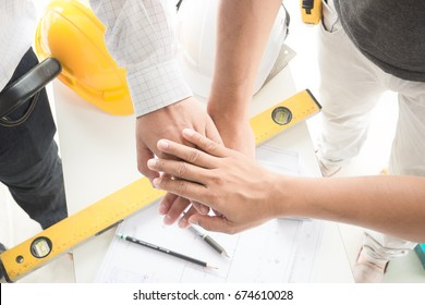 Estate agent shaking hands with customer after contract signature buy home.