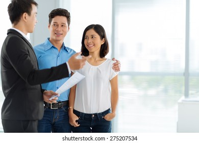Estate agent showing house to the Asian family