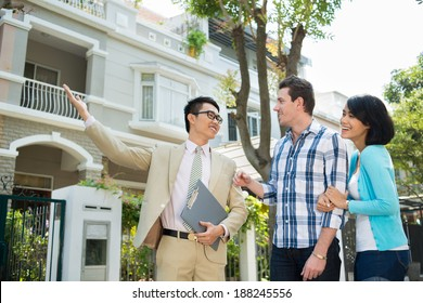 Estate agent showing a house to the young family