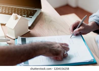 estate homes and sign contract,  house agency or banker pointing for buyer signing on paper