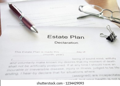 Estate Plan document on a desk with a pen and glasses