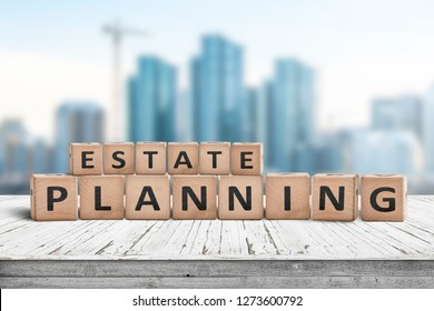 Estate planning sign on a wooden pier with tall buildings in the background