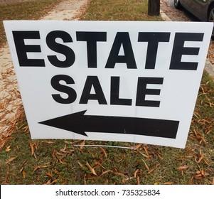 estate sale sign with left arrow
