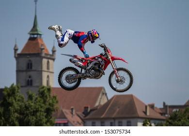 ESTAVAYER-LE-LAC, SWITZERLAND - JUL 06: FMX Rider Josh Sheehan (AUS) performs trick during the 2013 Swatch Free4style Competition on July 06, 2013 in Estavayer, Switzerland.
