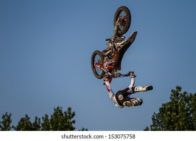 ESTAVAYER-LE-LAC, SWITZERLAND - JUL 06: FMX Rider Josh Sheehan (AUS) performing a backflip trick during the 2013 Swatch Free4style Competition on July 06, 2013 in Estavayer, Switzerland.