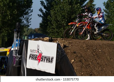 ESTAVAYER-LE-LAC, SWITZERLAND - JUL 06: FMX riders Mat Rebeaud (SWI) & Josh Sheehan(AUS) preparing for a duel during the 2013 Swatch Free4style Competition on July 06, 2013 in Estavayer, Switzerland.