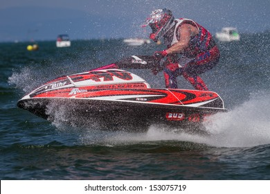 ESTAVAYER-LE-LAC, SWITZERLAND - JUL 06: Light Jetski speed-track competitor achieving final run during the 2013 Swatch Free4style Competition on July 06, 2013 in Estavayer, Switzerland