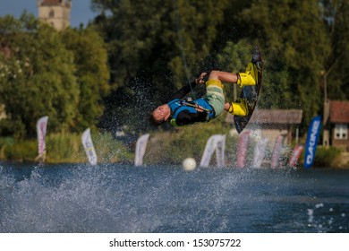 ESTAVAYER-LE-LAC, SWITZERLAND - JUL 06: REDBULL Wakeboard Team Member performs trick during the 2013 Swatch Free4style Competition on July 06, 2013 in Estavayer, Switzerland.