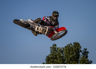 ESTAVAYER-LE-LAC, SWITZERLAND - JUL 06: REDBULL FMX Team Member performs trick during the 2013 Swatch Free4style Competition on July 06, 2013 in Estavayer, Switzerland.