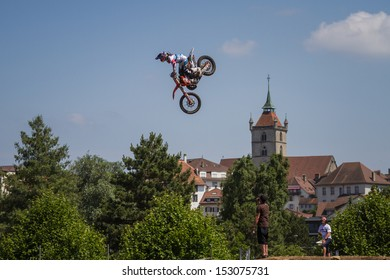 ESTAVAYER-LE-LAC, SWITZERLAND - JUL 06: Swiss FMX RedBull team rider Mat Rebeaud performs trick during the 2013 Swatch Free4style Competition on July 06, 2013 in Estavayer, Switzerland.