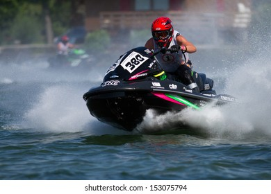ESTAVAYER-LE-LAC, SWITZERLAND - JUL 06: Swiss Jetski competitor Claude Baechler in the final run of the semis during the 2013 Swatch Free4style Competition on July 06, 2013 in Estavayer, Switzerland.